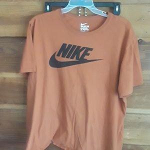 Burnt orange and black Nike shirt